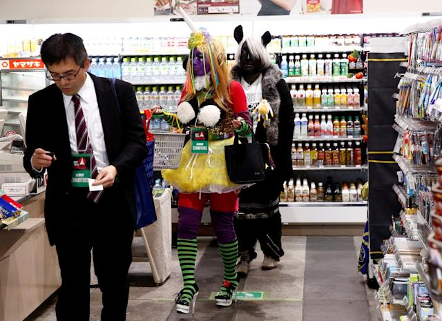 Women dressed in costumes buy goods at a convenience store at Tokyo Comic Con at Makuhari Messe in Chiba, Japan December 1, 2017. REUTERS/Kim Kyung-Hoon