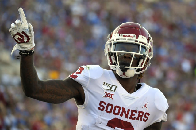 Oklahoma wide receiver CeeDee Lamb celebrates after scoring a touchdown during the first half of the teaam's NCAA college football game against UCLA on Saturday, Sept. 14, 2019, in Pasadena, Calif. (AP Photo/Mark J. Terrill)