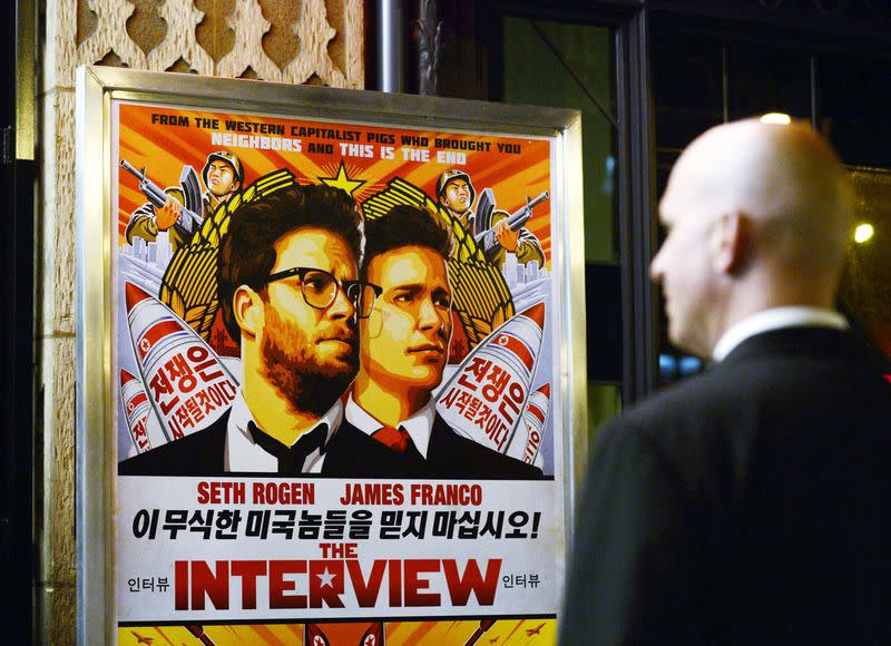 """File photo of a security guard standing at the entrance of United Artists theater during the premiere of the film """"The Interview"""" in Los Angeles"""