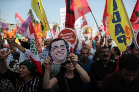 A supporter holds a mask of Selahattin Demirtas, detained leader of Turkey's Pro-Kurdish Peoples' Democratic Party  during a rally in Istanbul