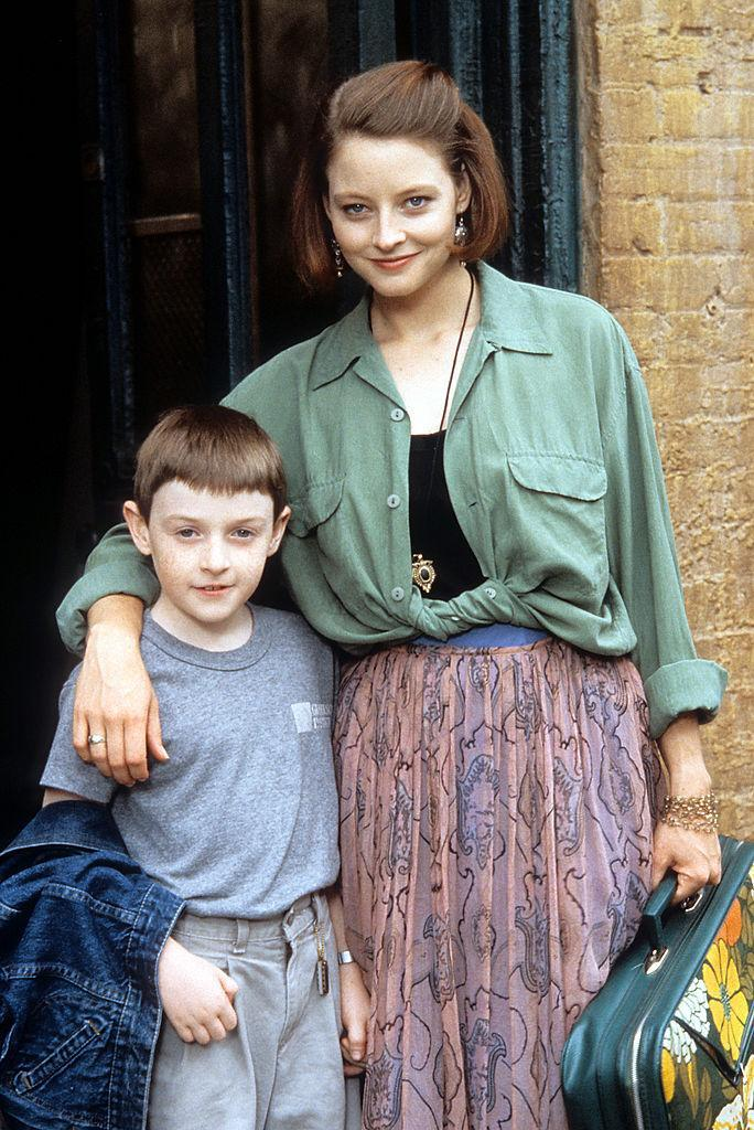 Jodie Foster with her arm around Adam Hann-Byrd in a scene from the film 'Little Man Tate', 1991.