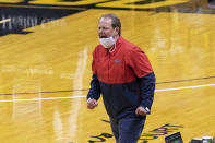 Mississippi coach Kermit Davis argues a call during the first half of the team's NCAA college basketball game against Missouri on Tuesday, Feb. 23, 2021, in Columbia, Mo. (AP Photo/L.G. Patterson)