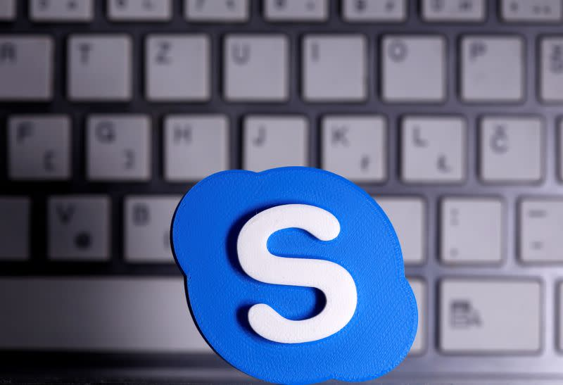 A 3D printed Skype logo is placed in front of keyboard in this illustration