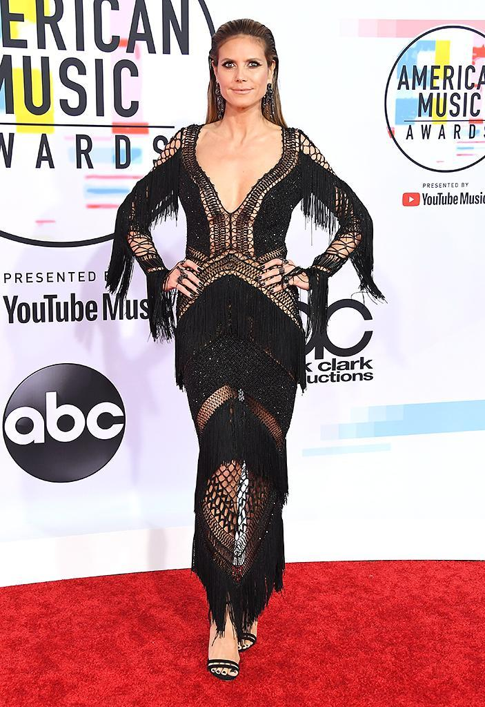 <p>At the show to present the award for Tour of the Year to Taylor Swift, the model stepped out in a black crochet dress with fringe. (Photo by Steve Granitz/WireImage) </p>