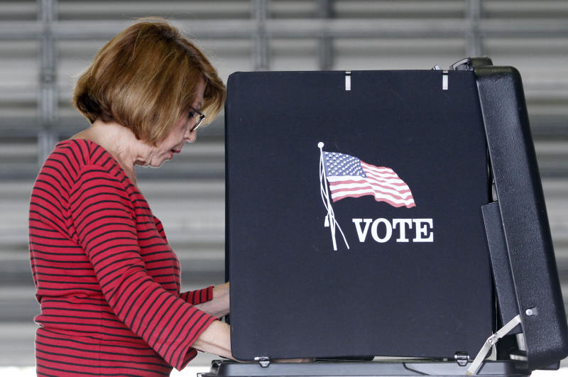 Lida Bonilla casts her vote during the Florida Primary elections in Hialeah, Fla., Tuesday, Aug. 14, 2012. (AP Photo/Alan Diaz)