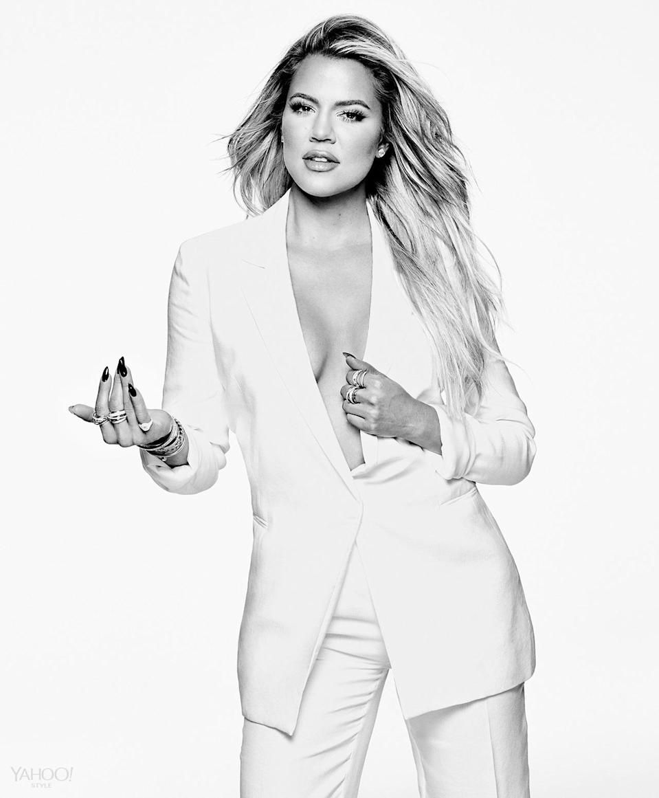 """<p>Khloé's new book, <i><a href=""""http://www.amazon.com/Strong-Looks-Better-Naked-Kardashian/dp/1942872488"""" rel=""""nofollow noopener"""" target=""""_blank"""" data-ylk=""""slk:Strong Looks Better Naked"""" class=""""link rapid-noclick-resp"""">Strong Looks Better Naked</a></i>, is out this week. In it, the most confident Kardashian shares her secrets to self-love. </p><p><i>Amanda Wakeley Blazer, Price Upon Request, <a href=""""http://www.amandawakeley.com/shop/lifestyle/tux-times"""" rel=""""nofollow noopener"""" target=""""_blank"""" data-ylk=""""slk:Amandawakeley.com"""" class=""""link rapid-noclick-resp"""">Amandawakeley.com</a><br>Amanda Wakeley Pants, Price Upon Request, <a href=""""http://www.amandawakeley.com/shop/lifestyle/tux-times"""" rel=""""nofollow noopener"""" target=""""_blank"""" data-ylk=""""slk:Amandawakeley.com"""" class=""""link rapid-noclick-resp"""">Amandawakeley.com</a><br>SHAY Baugette Orbit Ring in 18k Gold and Diamonds, $7,560, <a href=""""http://www.shayfinejewelry.com/"""" rel=""""nofollow noopener"""" target=""""_blank"""" data-ylk=""""slk:shayfinejewelry.com"""" class=""""link rapid-noclick-resp"""">shayfinejewelry.com</a><br>SHAY Essential Orbit Ring in 18k Gold and Diamond Orbit Ring, $5,460, <a href=""""http://www.shayfinejewelry.com/"""" rel=""""nofollow noopener"""" target=""""_blank"""" data-ylk=""""slk:http://www.shayfinejewelry.com/"""" class=""""link rapid-noclick-resp"""">http://www.shayfinejewelry.com/</a><br>SHAY 5 Row Closed Mixed Diamond Ring, $7,140, <a href=""""http://www.shayfinejewelry.com/"""" rel=""""nofollow noopener"""" target=""""_blank"""" data-ylk=""""slk:http://www.shayfinejewelry.com/"""" class=""""link rapid-noclick-resp"""">http://www.shayfinejewelry.com/</a><br>SHAY Essential Pave Link Barcelet, $16,380, <a href=""""http://www.shayfinejewelry.com/"""" rel=""""nofollow noopener"""" target=""""_blank"""" data-ylk=""""slk:shayfinejewelry.com"""" class=""""link rapid-noclick-resp"""">shayfinejewelry.com</a><br>SHAY Essential Link Pavé ID Bracelet in 18K Gold and Diamonds, $10,080, <a href=""""http://www.shayfinejewelry.com/"""" rel=""""nofollow noopener"""" target=""""_blank"""" data-ylk=""""slk:shayfinejewelry.com"""" class=""""link ra"""
