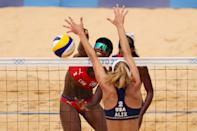<p>Leila Consuelo Martinez Ortega #2 of Team Cuba hits past Alix Klineman #2 of Team United States during the Women's Round of 16 beach volleyball on day ten of the Tokyo 2020 Olympic Games at Shiokaze Park on August 02, 2021 in Tokyo, Japan. (Photo by Clive Brunskill/Getty Images)</p>