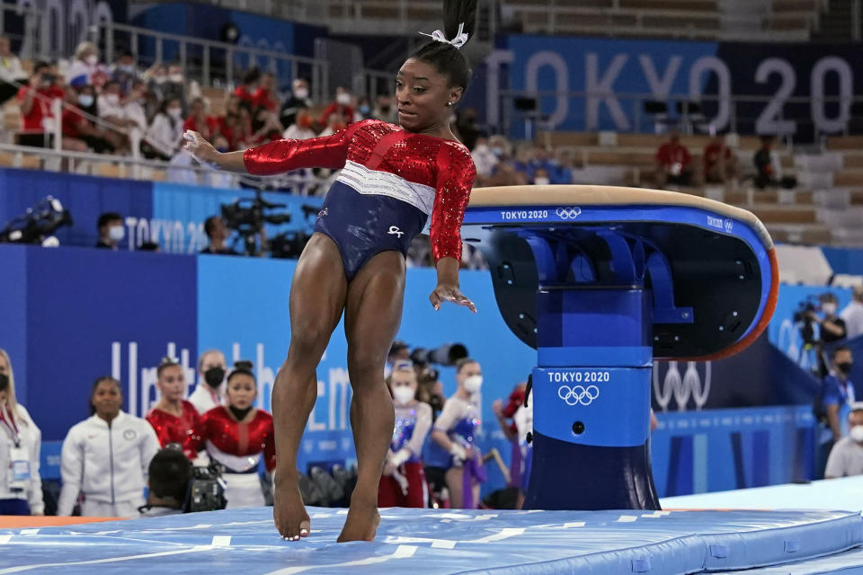 Simone Biles, of the United States, lands from the vault during the artistic gymnastics women's final at the 2020 Summer Olympics, Tuesday, July 27, 2021, in Tokyo. (AP Photo/Gregory Bull)