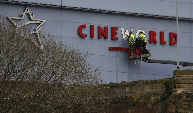 Workers repair a sign at a Cineworld cinema in Bradford northern England.
