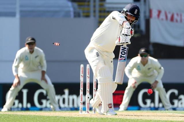 """""""It just wasn't to be"""": Moeen Ali is bowled by Tim Southee to reduce England to 23-8 in Auckland in 2018, but some late hitting ensured New Zealand kept their embarrassing record all-time low Test score of 26 all out (AFP Photo/Fiona Goodall)"""
