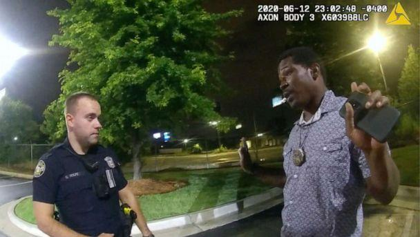 PHOTO: In this screen grab taken from body camera video provided by the Atlanta Police Department Rayshard Brooks, right, speaks with Officer Garrett Rolfe, left, in the parking lot of a Wendy's restaurant, in Atlanta, June 12, 2020. (Atlanta Police Department via AP, FILE)