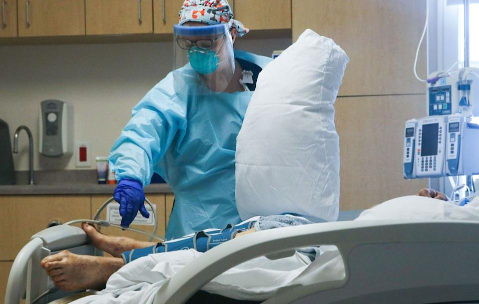 A nurse cares for a COVID-19 patient at a Californian hospital where cases continue to surge in the state. Source: Getty