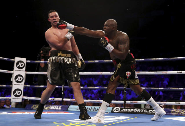 Dillian Whyte, right, connects with a punch against Joseph Parker during their heavyweight bout at the O2 Arena in London, Saturday, July 28, 2018. (Nick Potts/PA via AP)