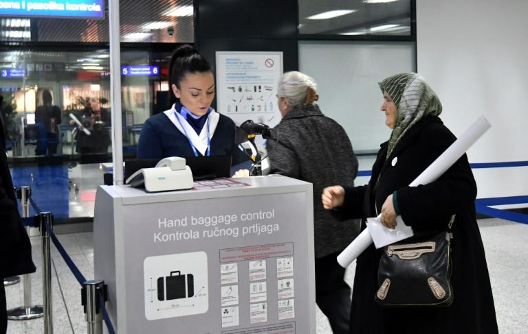 Srebrenica massacre survivor Fatima Gurdic, seen checking in for her flight to The Hague from Sarajevo, will be among those following proceedings Wednesday when a verdict is expected in the UN trial of Bosnian Serb military chief Ratko Mladic