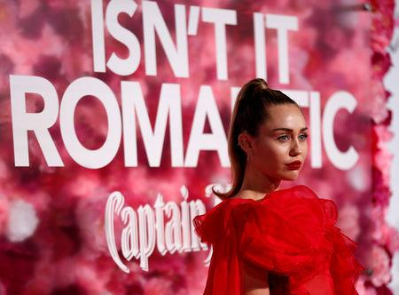 "Singer Cyrus poses at the premiere for the movie ""Isn't It Romantic"" in Los Angeles"