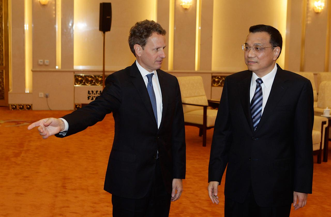 BEIJING, CHINA - MAY 3: U.S. Treasury Secretary Timothy Geithner (L) shakes hands with China's Vice Premier Li Keqiang during a meeting at the Great Hall of the People on May 4, 2012 in Beijing. Hillary Clinton is in China for bilateral talks and has called on China to protect human rights.  (Photo by Jason Lee/Pool/Getty Images)
