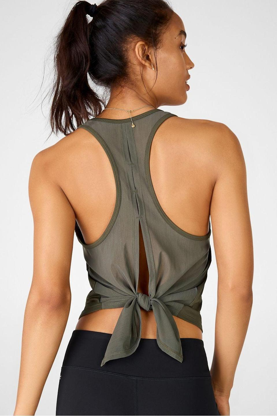 "<p>You can't go wrong with this classic <a href=""https://www.popsugar.com/buy/Fabletics-Mina-Tie-Up-Tank-586511?p_name=Fabletics%20Mina%20Tie%20Up%20Tank&retailer=fabletics.com&pid=586511&price=15&evar1=fit%3Auk&evar9=46472938&evar98=https%3A%2F%2Fwww.popsugar.com%2Ffitness%2Fphoto-gallery%2F46472938%2Fimage%2F47590619%2FFabletics-Mina-Tie-Up-Tank&list1=shopping%2Cworkout%20clothes%2Cfitness%20gear%2Cproducts%20under%20%2450%2C50%20under%20%2450%2Cfitness%20shopping%2Caffordable%20shopping&prop13=api&pdata=1"" class=""link rapid-noclick-resp"" rel=""nofollow noopener"" target=""_blank"" data-ylk=""slk:Fabletics Mina Tie Up Tank"">Fabletics Mina Tie Up Tank</a> ($15, originally $40).</p>"