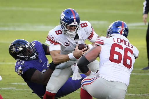 Baltimore Ravens defensive tackle Justin Madubuike, left, sacks New York Giants quarterback Daniel Jones (8) during the second half of an NFL football game, Sunday, Dec. 27, 2020, in Baltimore. (AP Photo/Nick Wass)