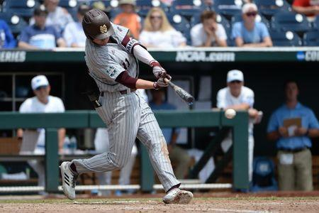 Jun 19, 2018; Omaha, NE, USA; Mississippi State Bulldogs designated hitter Jordan Westburg (11) drives in three runs with a double in the eighth inning against the North Carolina Tar Heels in the College World Series at TD Ameritrade Park. Mandatory Credit: Steven Branscombe-USA TODAY Sports