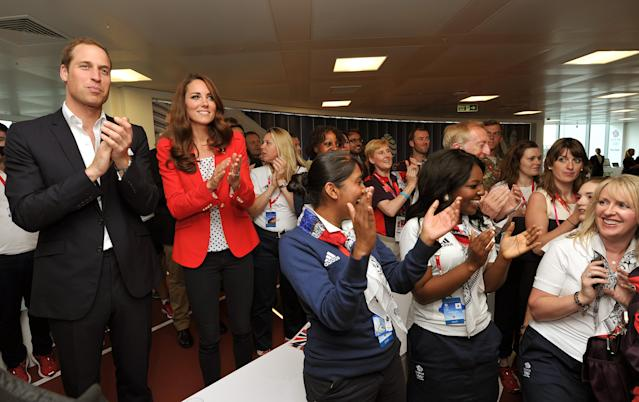 LONDON - UNITED KINGDOM - AUGUST 03: Prince William, Duke of Cambridge and Catherine, Duchess of Cambridge applaud the gold medal victory by the Team GB Men's Team Pursuit in the Track Cycling during a visit to the Team GB House, the main operations centre situated in the Westfield Centre in Stratford on August 3, 2012 in London, England. The Duke and Duchess of Cambridge had requested the visit be arranged in order to allow them to say thank you to volunteers for playing their part in the staging of the games. (Photo by John Stillwell - Pool/Getty Images)