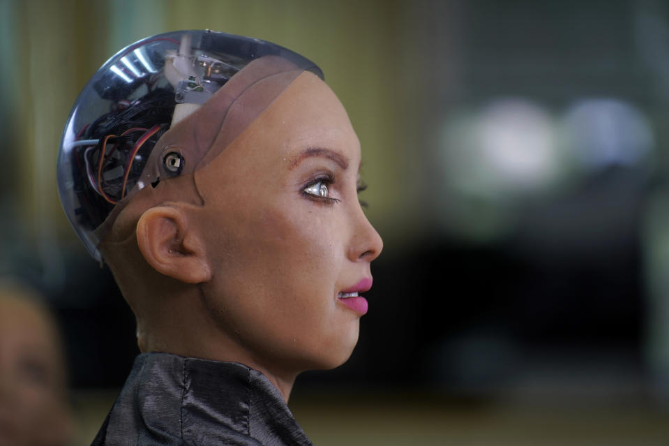 The head of Sophia is seen at Hanson Robotics studio in Hong Kong on March 29, 2021. Sophia is a robot of many talents — she speaks, jokes, sings and even makes art. In March, she caused a stir in the art world when a digital work she created as part of a collaboration was sold at an auction for $688,888 in the form of a non-fungible token (NFT). (AP Photo/Vincent Yu)