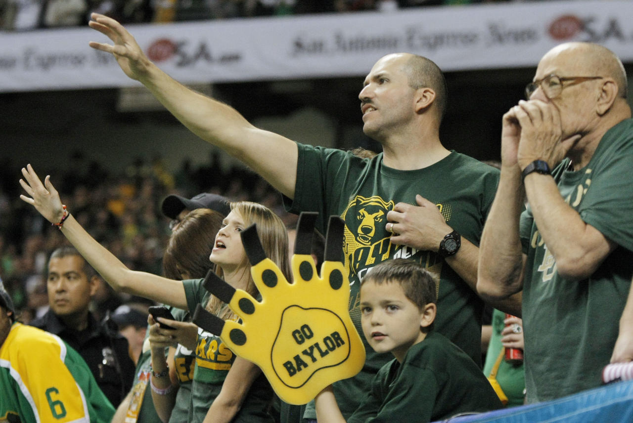 Baylor fans cheer during the second half of the Alamo Bowl college football game against Washington, Thursday, Dec. 29, 2011, at the Alamodome in San Antonio. Baylor pulled out a thrilling Alamo Bowl victory in the highest-scoring bowl game in history, beating Washington 67-56 in a record-smashing shootout Thursday night. (AP Photo/Darren Abate)