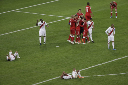 Denmark players celebrate after winning the group C match between Peru and Denmark at the 2018 soccer World Cup in the Mordovia Arena in Saransk, Russia, Saturday, June 16, 2018. (AP Photo/Gregorio Borgia)