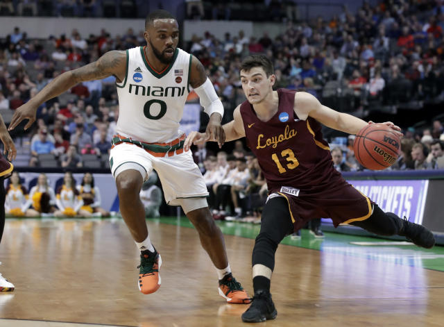 Miami guard Ja'Quan Newton (0) defends against a drive to the basket by Loyola-Chicago guard Clayton Custer (13) in the first half of a first-round game of the NCAA college basketball tournament in Dallas, Thursday, March 15, 2018. (AP Photo/Tony Gutierrez)