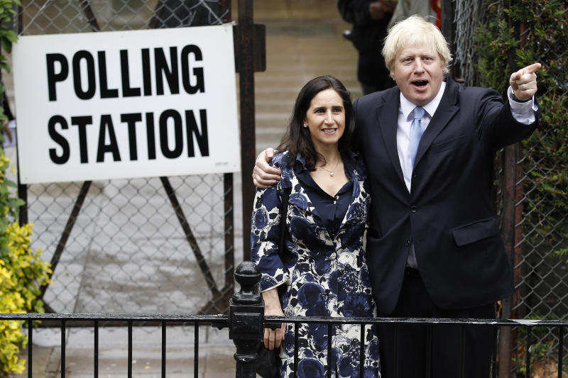 London Mayor Boris Johnson poses with his wife Marina Wheeler (L) after casting his vote in Islington, London May 3, 2012. REUTERS/Stefan Wermuth (BRITAIN - Tags: POLITICS ELECTIONS)
