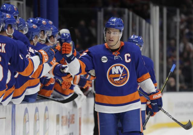 New York Islanders' Anders Lee celebrates with teammates after scoring a goal during the first period of an NHL hockey game against the New Jersey Devils, Thursday, Jan. 17, 2019, in Uniondale, N.Y. (AP Photo/Frank Franklin II)