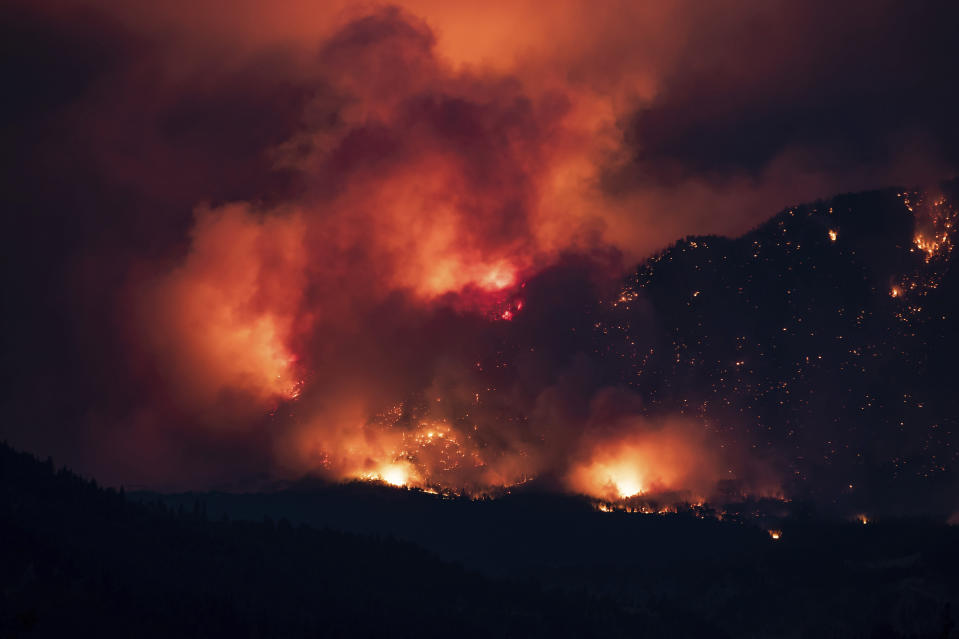 A wildfire burns on the side of a mountain in Lytton, B.C., Thursday, July 1, 2021. (Darryl Dyck/The Canadian Press via AP)