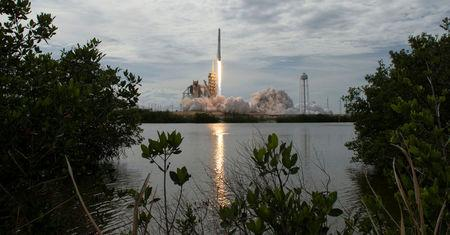 FILE PHOTO: NASA handout photo of the SpaceX Falcon 9 rocket launching from pad 39A at the Kennedy Space Center in Cape Canaveral