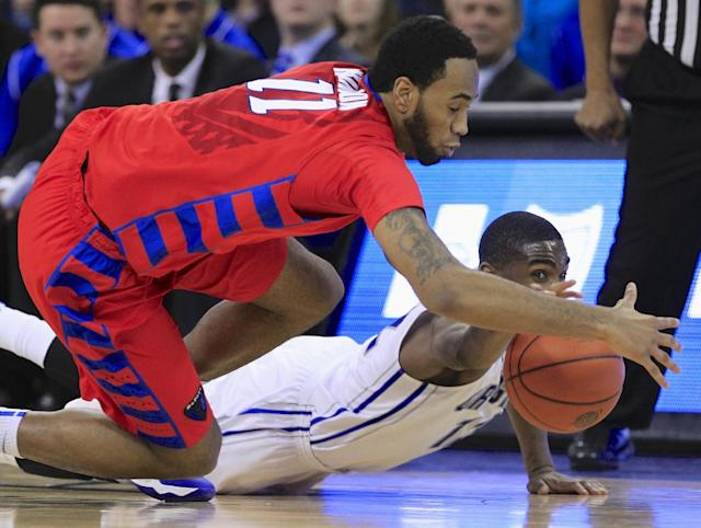 DePaul's Forrest Robinson (11) and Creighton's Jahenns Manigat (12) scramble for a loose ball in the first half of an NCAA college basketball game in Omaha, Neb., Friday, Feb. 7, 2014. (AP Photo/Nati Harnik)