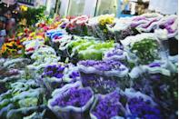"""<p>It might be easier to grab a bouquet from the store, but you are often overpaying for floral arrangements that are less than pristine. """"I find that the pre-made grocery store bouquets are often less fresh,"""" writes Faith Durand on <a href=""""http://www.apartmenttherapy.com/"""" rel=""""nofollow noopener"""" target=""""_blank"""" data-ylk=""""slk:Apartment Therapy"""" class=""""link rapid-noclick-resp"""">Apartment Therapy</a>. """"They seem to wilt faster. Also, they are usually padded with a great deal of unnecessary greenery."""" This doesn't mean you need to skip grocery store flowers altogether. However, Durand recommends just buying single <a href=""""https://www.womansday.com/home/decorating/g1541/flower-arrangements/"""" rel=""""nofollow noopener"""" target=""""_blank"""" data-ylk=""""slk:varieties of flowers"""" class=""""link rapid-noclick-resp"""">varieties of flowers</a>, looking for the freshest bunch with buds that aren't fully opened yet. You can then always create your own colorful bouquet. </p>"""