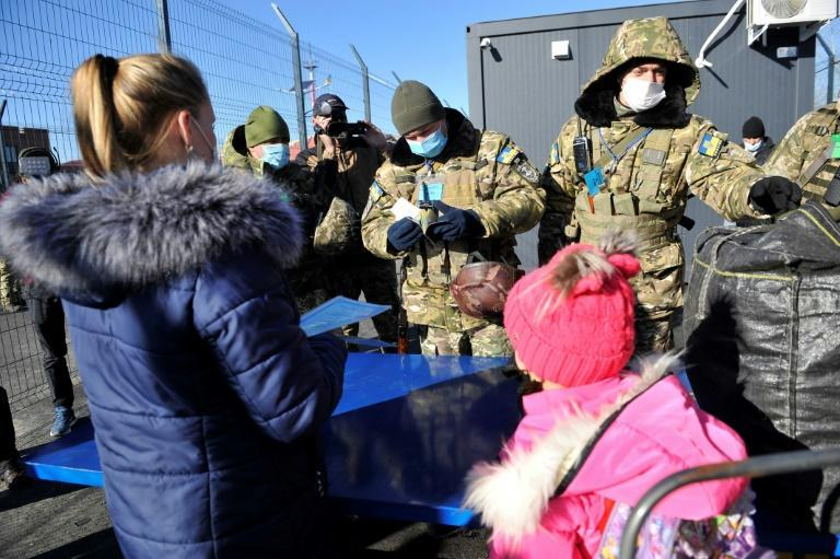 People laden with bags approached the crossing point at Schastya but were soon turned back by separatist authorities in Lugansk region