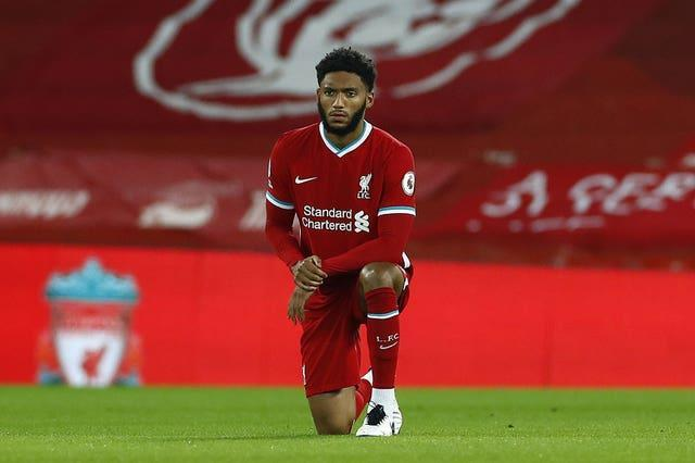 Liverpool centre-back Joe Gomez takes a knee