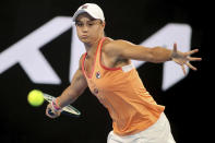 Australia's Ash Barty makes a forehand return to Romania's Simona Halep during an exhibition tennis event in Adelaide, Australia, Friday, Jan 29. 2021. (Kelly Barnes/AAP Image via AP)