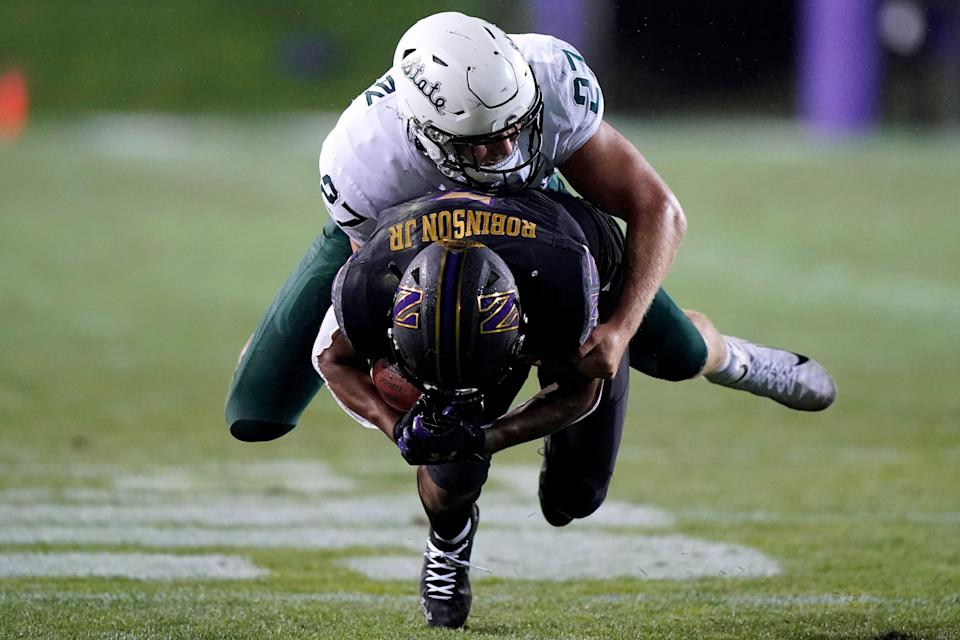 Michigan State linebacker Cal Haladay, top, tackles Northwestern wide receiver Stephon Robinson Jr. during the second half of an NCAA college football game in Evanston, Ill., Friday, Sept. 3, 2021. Michigan State won 38-21.