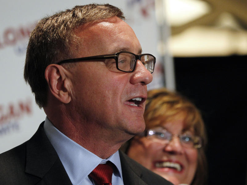 Republican U.S. Senate candidate Steve Lonegan with his wife Lorraine by his side, makes his victory speech after defeating Alieta Eck for the nomination in the special election primary in Secaucus, N.J. Tuesday, Aug. 13, 2013. (AP Photo/Rich Schultz)