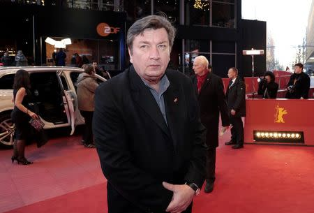 Director Aki Kaurismaki arrives for the screening of the movie 'The Other Side of Hope' at the 67th Berlinale International Film Festival in Berlin, February 14, 2017. REUTERS/Axel Schmidt