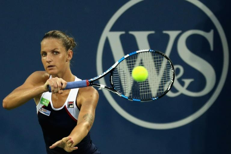 Karolina Pliskova of Czech Republic returns a shot to Natalia Vikhlyantseva of Russia during the Western & Southern Open, at the Linder Family Tennis Center in Mason, Ohio, on August 16, 2017