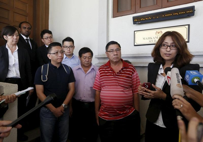 File picture shows lawyer Sangeet Deo (right) speaking to members of the media, accompanied by relatives of passengers Tan Ah Meng, his wife Chuang Hsiu Ling, and son Tan Wei Chew, who were aboard the missing Malaysia Airlines flight MH370. — Reuters pic