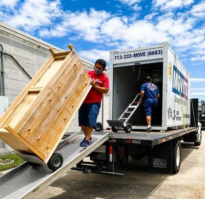 3 Men Movers facilitates furniture donations to Women's Center