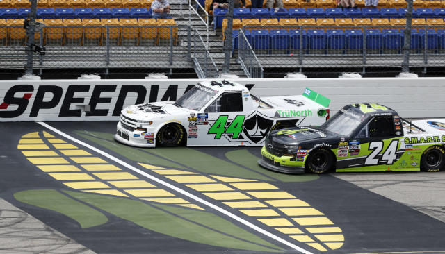 Ross Chastain (44) leads Brett Moffitt (24) during a restart in a NASCAR Truck Series auto race, Sunday, June 16, 2019, at Iowa Speedway in Newton, Iowa. (AP Photo/Charlie Neibergall)