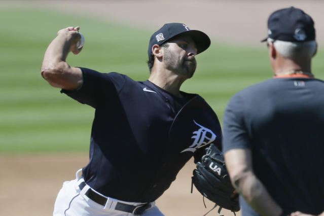 Detroit Tigers pitcher Michael Fulmer is observed by pitching coach Rick Anderson, right, during baseball training camp at Comerica Park, Friday, July 3, 2020, in Detroit. (AP Photo/Duane Burleson)