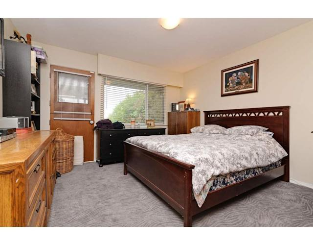 <p><span>324 Blue Mountain St., Coquitlam, B.C.</span><br>There are three bedrooms, including two on the main level and one in the basement. There are also two bathrooms.<br> (Photo: Zoocasa) </p>