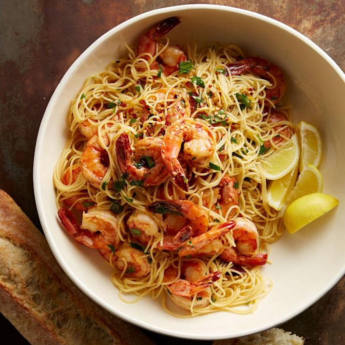 """<p>Shrimp scampi is a favorite dish at many Italian restaurants but our version takes just 20 minutes to prepare, so it's perfect for a weeknight dinner at home. Large shrimp are cooked with garlic and then served over linguine pasta with a buttery-wine sauce--it's so good your family may think you ordered takeout!</p> <p> <a href=""""http://www.eatingwell.com/recipe/269213/shrimp-scampi/"""" rel=""""nofollow noopener"""" target=""""_blank"""" data-ylk=""""slk:View recipe"""" class=""""link rapid-noclick-resp""""> View recipe </a></p>"""