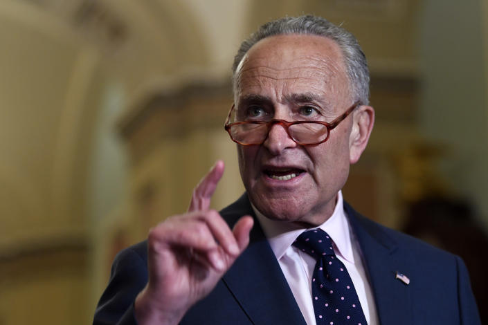 Senate Minority Leader Sen. Chuck Schumer of N.Y., center, speaks to reporters following the weekly policy luncheon on Capitol Hill in Washington, Tuesday, July 9, 2019. (AP Photo/Susan Walsh)