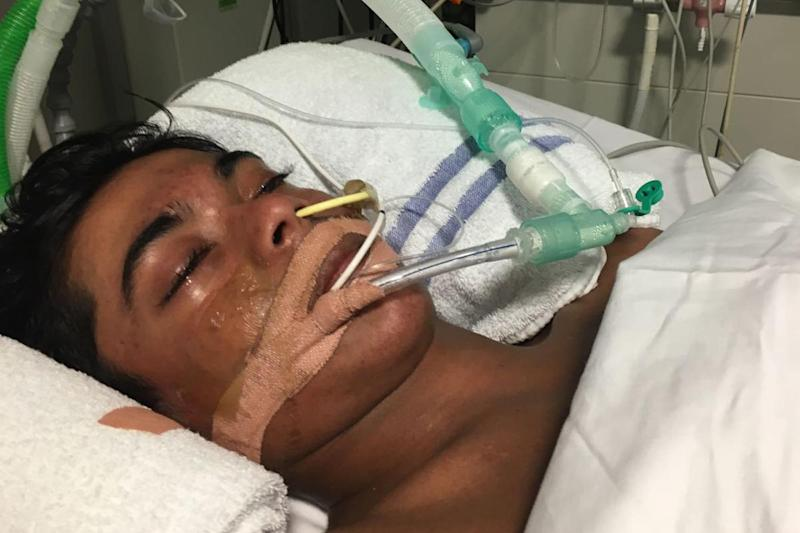 Nasar Ahmed, 14, pictured here in hospital in an image released by his family, stopped breathing in an exclusion room at Bow School in Tower Hamlets
