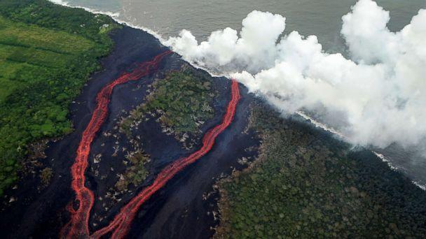 PHOTO: Steam plumes rise as lava enters the Pacific Ocean, after flowing to the water from a Kilauea volcano fissure, on Hawaii's Big Island, May 21, 2018, near Pahoa, Hawaii. (Mario Tama/Getty Images)